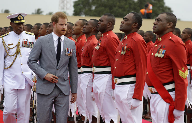 Britain's Prince Harry inspects a guard of honour at his official welcome ceremony in Suva, Fiji, Tuesday, Oct. 23, 2018. Prince Harry and his wife Meghan are on day eight of their 16-day tour of Australia and the South Pacific.(AP Photo/Kirsty Wigglesworth,Pool)