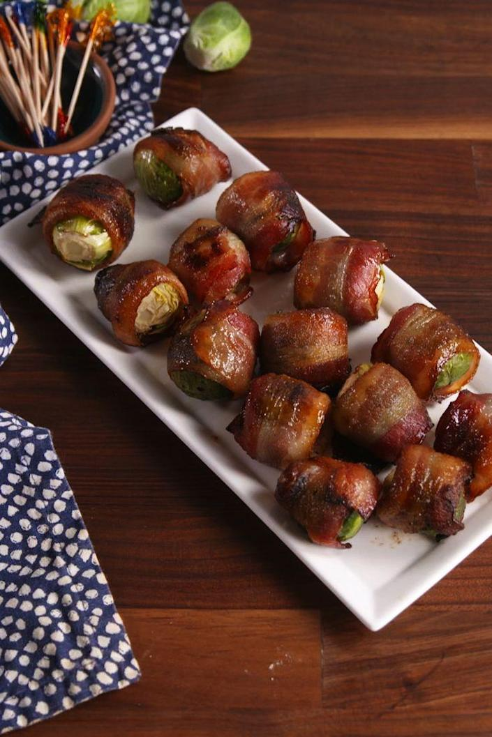 """<p>Brussels sprouts have never been so wonderful.</p><p>Get the recipe from <a href=""""https://www.delish.com/cooking/recipe-ideas/recipes/a57257/candied-bacon-brussels-sprouts-recipe/"""" rel=""""nofollow noopener"""" target=""""_blank"""" data-ylk=""""slk:Delish"""" class=""""link rapid-noclick-resp"""">Delish</a>.</p><p><strong><a class=""""link rapid-noclick-resp"""" href=""""https://go.redirectingat.com?id=74968X1596630&url=https%3A%2F%2Fwww.barnesandnoble.com%2Fw%2Fdelish-editors-of-delish%2F1127659306%3Fst%3DAFF%26SID%3DBarnes%2B%2526%2BNoble%2B-%2BTop%2B100%253A%2BBook%2BBestsellers%262sid%3DSkimlinks_7689440_NA&sref=https%3A%2F%2Fwww.delish.com%2Fholiday-recipes%2Fchristmas%2Fg1421%2Fchristmas-side-dishes%2F"""" rel=""""nofollow noopener"""" target=""""_blank"""" data-ylk=""""slk:GET YOURS NOW"""">GET YOURS NOW</a><em> Delish Cookbook, </em><em>barnesandnoble.com</em> </strong></p>"""