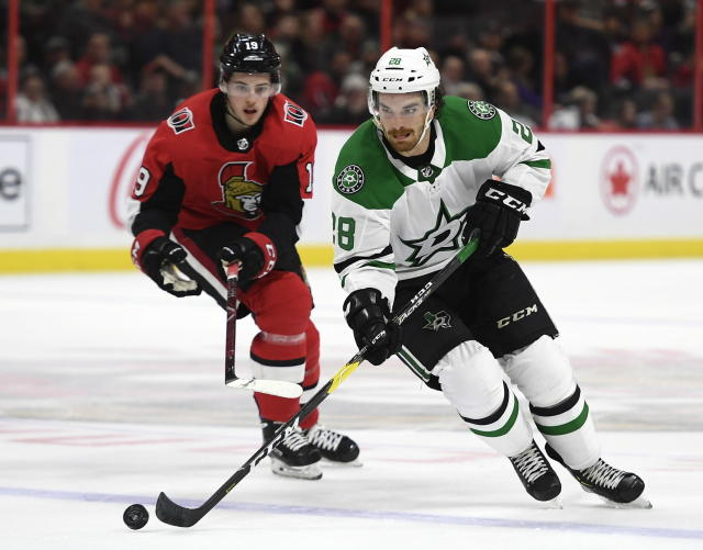 Dallas Stars defenseman Stephen Johns (28) skates with the puck in front of Ottawa Senators right wing Drake Batherson (19) during the second period of an NHL hockey game Sunday, Feb. 16, 2020, in Ottawa, Ontario. (Justin Tang/The Canadian Press via AP)