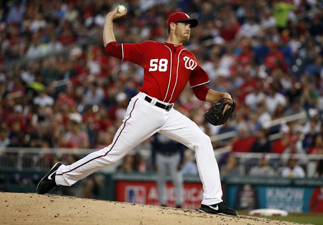 Washington Nationals starting pitcher Doug Fister throws during the third inning of a baseball game against the Atlanta Braves at Nationals Park on Saturday, June 21, 2014, in Washington. (AP Photo/Alex Brandon)