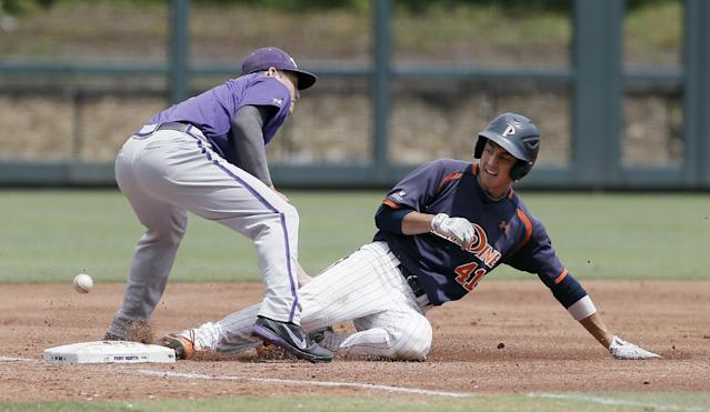 TCU third baseman Derek Odell, left, is unable to catch the throw as Pepperdine's Brandon Caruso (41) slides into third on a triple during the first inning of an NCAA college baseball tournament super regional game in Fort Worth, Texas, Monday, June 9, 2014. (AP Photo/Brandon Wade)