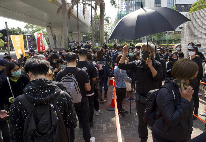 Supporters queue up outside a court to try to get in for a hearing in Hong Kong Monday, March 1, 2021. Pro-democracy activists detained by police on Sunday on charges of conspiracy to commit subversion under the sweeping national security law, are expected to appear in court. (AP Photo/Vincent Yu)