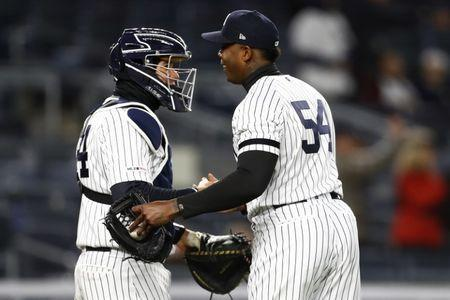 Apr 1, 2019; Bronx, NY, USA; New York Yankees relief pitcher Aroldis Chapman (54) and New York Yankees catcher Gary Sanchez (24) celebrate after defeating the Detroit Tigers at Yankee Stadium. Mandatory Credit: Adam Hunger-USA TODAY Sports