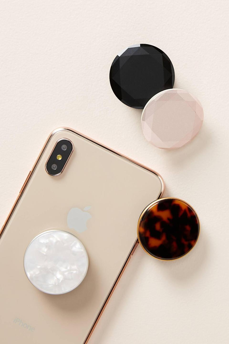 """<p><strong>PopSockets Anthropologie</strong></p><p>anthropologie.com</p><p><strong>$20.00</strong></p><p><a href=""""https://go.redirectingat.com?id=74968X1596630&url=https%3A%2F%2Fwww.anthropologie.com%2Fshop%2Fpopsockets-phone-stand&sref=https%3A%2F%2Fwww.prevention.com%2Flife%2Fg30025627%2Fcheap-stocking-stuffers%2F"""" rel=""""nofollow noopener"""" target=""""_blank"""" data-ylk=""""slk:Shop Now"""" class=""""link rapid-noclick-resp"""">Shop Now</a></p><p>If you've been thinking about jumping on the PopSocket bandwagon, meet the classiest ones we've seen yet! </p>"""