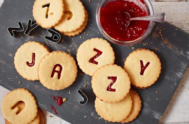 """<p>Homebaked jammie dodgers are sure to prove a hit with the kids (and parents). These alphabet-shaped biscuits take 15 minutes to prep – perfect for keeping the kids occupied after school. For the full recipe, visit <a href=""""https://realfood.tesco.com/recipes/jazzy-jammie-dodgers.html"""" rel=""""nofollow noopener"""" target=""""_blank"""" data-ylk=""""slk:Tesco"""" class=""""link rapid-noclick-resp"""">Tesco</a>. </p>"""