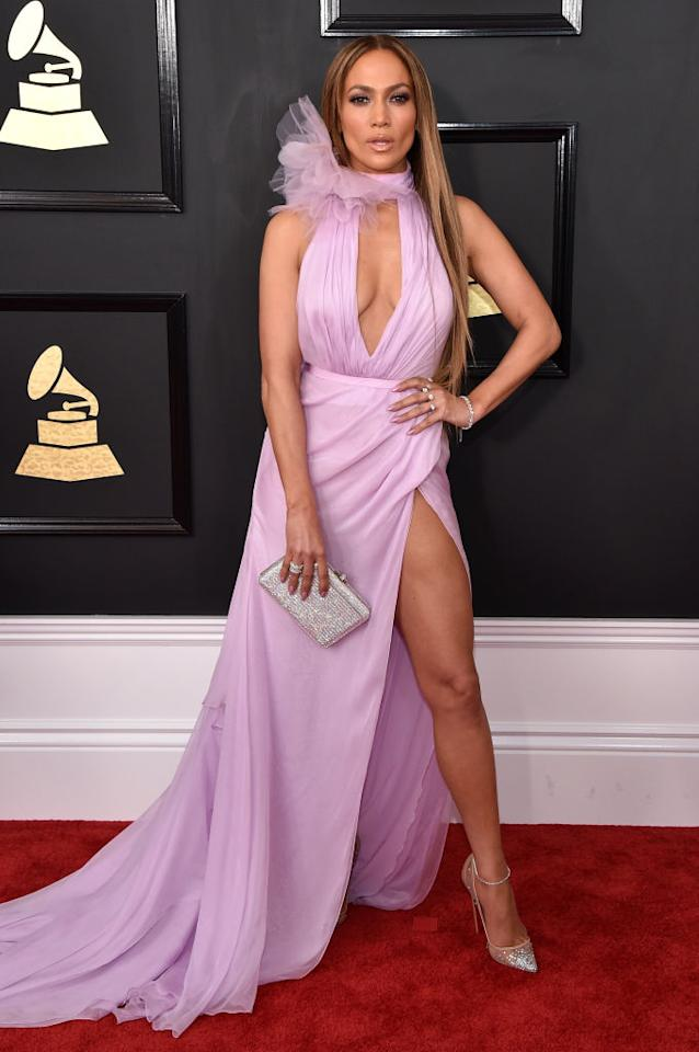 <p>Jennifer Lopez consistently makes sexy statements on the red carpet, and the Grammys was no exception. The Ralph & Russo lilac gown featured a keyhole cutout and high leg slit. While only 61 percent of voters were enthused about Lopez's gown, it most likely would've been even more positively received had the layered tulle halter neck not been added. (Photo: Getty Images) </p>
