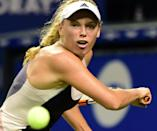 Caroline Wozniacki keeps her eye on the ball in her match against Angelique Kerber in their Pan Pacific Open quarter-final in Tokyo on September 25, 2015 (AFP Photo/)