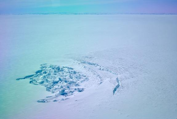 A surface crater in southwest Greenland that formed after a lake under the ice emptied and drained away.