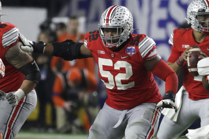 Ohio State OG Wyatt Davis (52) has the look of a first-round pick in the 2021 NFL draft. (AP Photo/Rick Scuteri).
