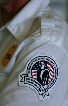 An arm patch featuring an eagle and an American flag.
