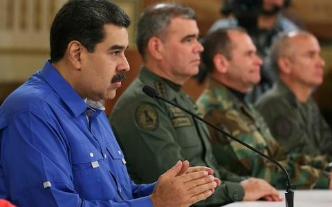 Maduro appears flanked by Venezuela's Defence Minister and two top military commanders in a photo released on Tuesday by the Miraflores Press Office