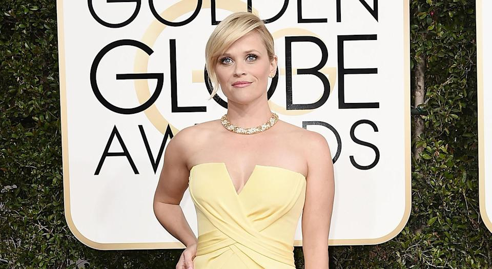 Reese Witherspoon, along with A-listers like Shonda Rhimes and Emma Stone, started the Time's Up movement to fight sexual harassment and curated a pin for it. (Photo: Getty Images)