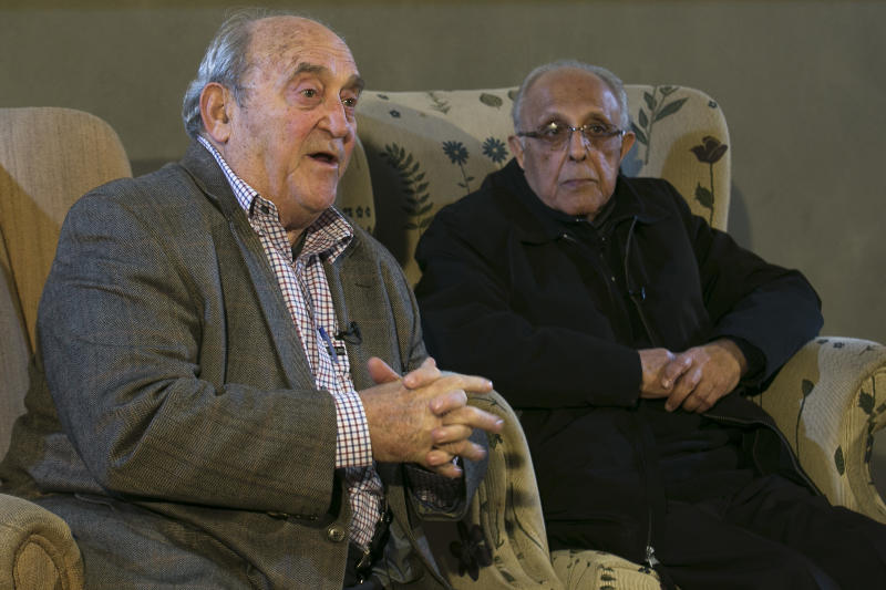 Denis Goldberg, left, and Ahmed Kathadra, friends and prisoners with former South African President Nelson Mandela, attends an event of the 50th anniversary of the raid against him and other former African National Congress leaders at the Liliesleaf Farm in the outskirts of Johannesburg, South Africa, Monday, July 8, 2013. Mandela remains in a critical condition in a hospital in Pretoria. (AP Photo/Markus Schreiber)