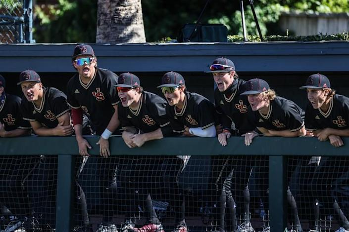 Encino, CA, Tuesday, March 23, 2021 - JSerra Catholic players cheer on teammates during a game against Harvard Westlake at O'Malley Family Field. Robert Gauthier/Los Angeles Times)