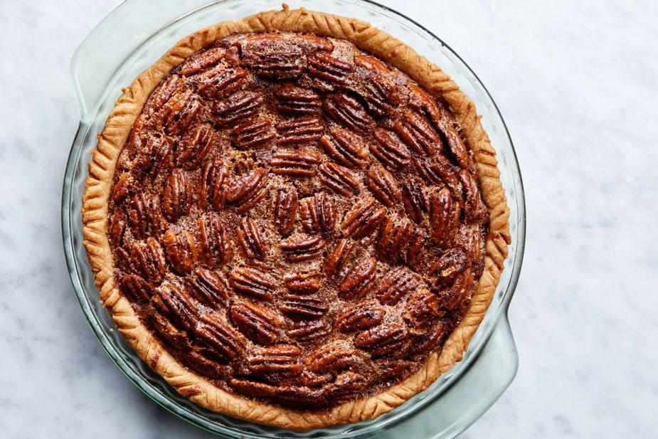 """Attention pecan pie lovers! This is the classic back-of-the-bottle recipe, and it's as easy as can be. <a href=""""https://www.epicurious.com/recipes/food/views/karo-classic-pecan-pie?mbid=synd_yahoo_rss"""" rel=""""nofollow noopener"""" target=""""_blank"""" data-ylk=""""slk:See recipe."""" class=""""link rapid-noclick-resp"""">See recipe.</a>"""