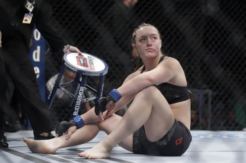 Aspen Ladd reacts after being defeated by Germaine de Randamie during a women's bantamweight mixed martial arts bout at UFC Fight Night in Sacramento, Calif., Saturday, July 13, 2019. De Randamie won by first-round knockout. (AP Photo/Jeff Chiu)
