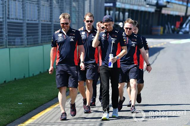 """Alex Albon, Red Bull Racing walks the track with members of his team <span class=""""copyright"""">Mark Sutton / Motorsport Images</span>"""