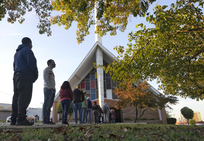 Voters line up outside Vickery Baptist Church waiting to cast their ballots on Election Day Tuesday, Nov. 3, 2020, in Dallas. (AP Photo/LM Otero)
