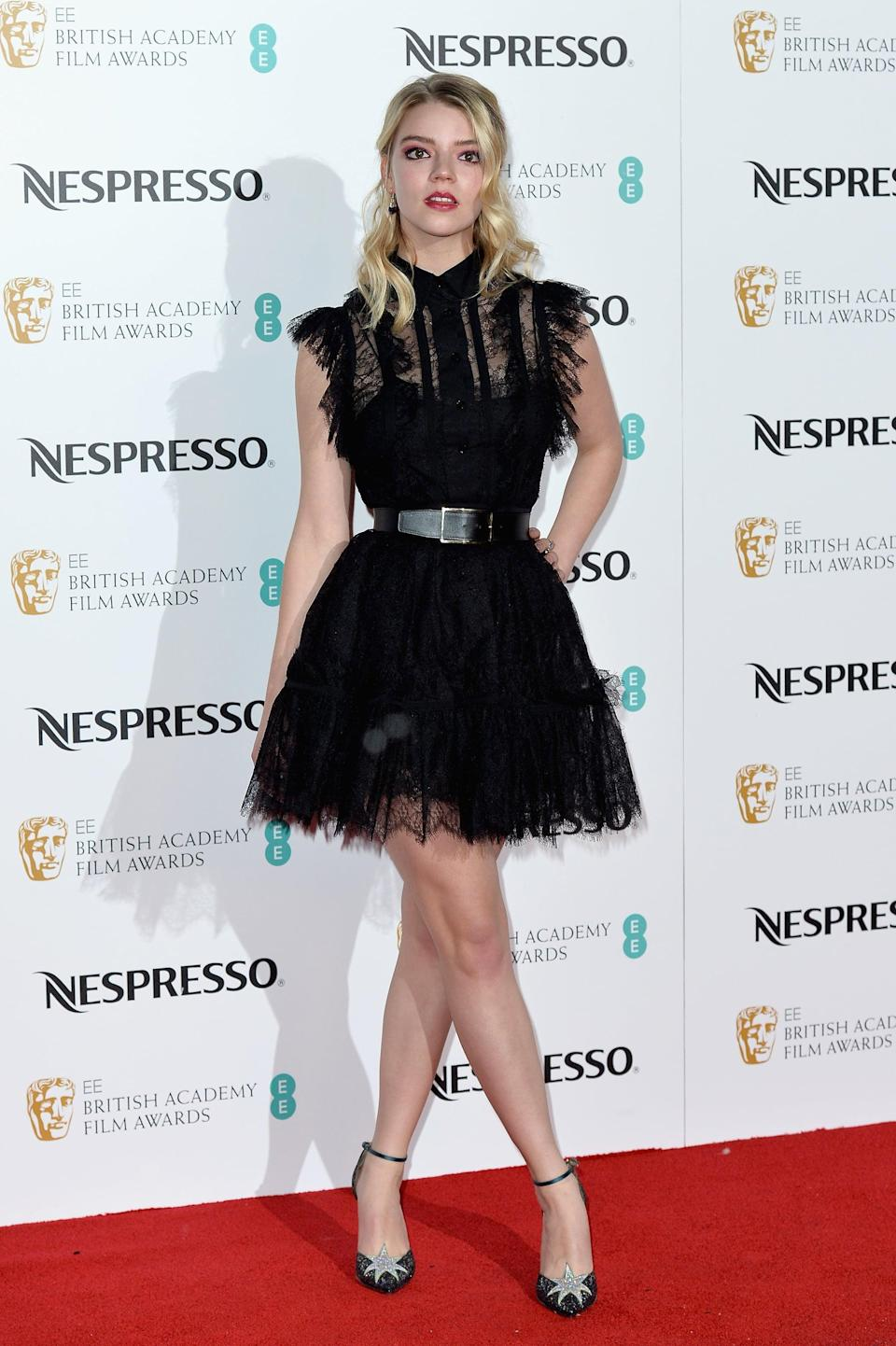<p>Anya wore an Elie Saab LBD cinched in at the waist.</p>