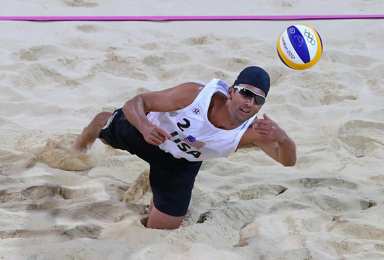 LONDON, ENGLAND - JULY 30:  Sean Rosenthal of the United States dives for a shot during the Men's Beach Volleyball Preliminary match between United States and Poland on Day 3 of the London 2012 Olympic Games at Horse Guards Parade on July 30, 2012 in London, England.  (Photo by Ryan Pierse/Getty Images)