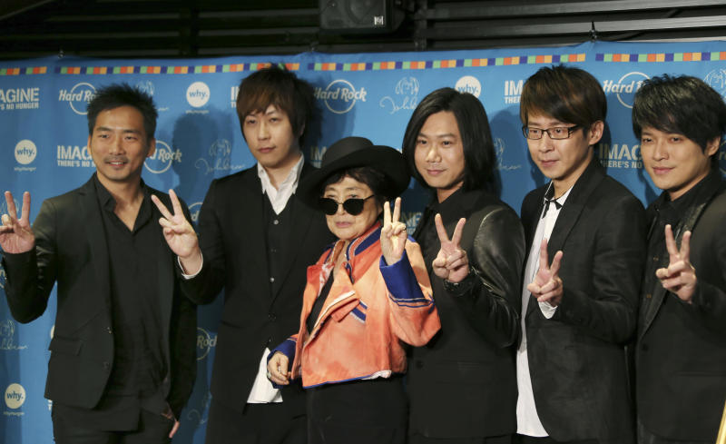 "Yoko Ono poses for photos with members of the Taiwanese rock band ""Mayday""during a campaign to fight childhood hunger around the world, in Tokyo Thursday, Dec. 5, 2013. The 80-year-old widow of John Lennon said that she believes he would be happy to see his song ""Imagine"" used by WhyHunger and Hard Rock to raise support for their child nutrition and sustainable farming efforts in 22 countries. Mayday members are, from left, Stone, Ashin, Masa, Ming and Monster. (AP Photo/Koji Sasahara)"