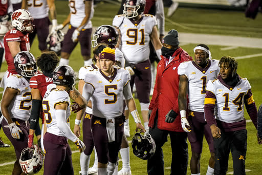 Minnesota quarterback Zack Annexstad (5) walks off the field with teammates after Wisconsindefeated them in overtime of an NCAA college football game Saturday, Dec. 19, 2020, in Madison, Wis. (AP Photo/Andy Manis)