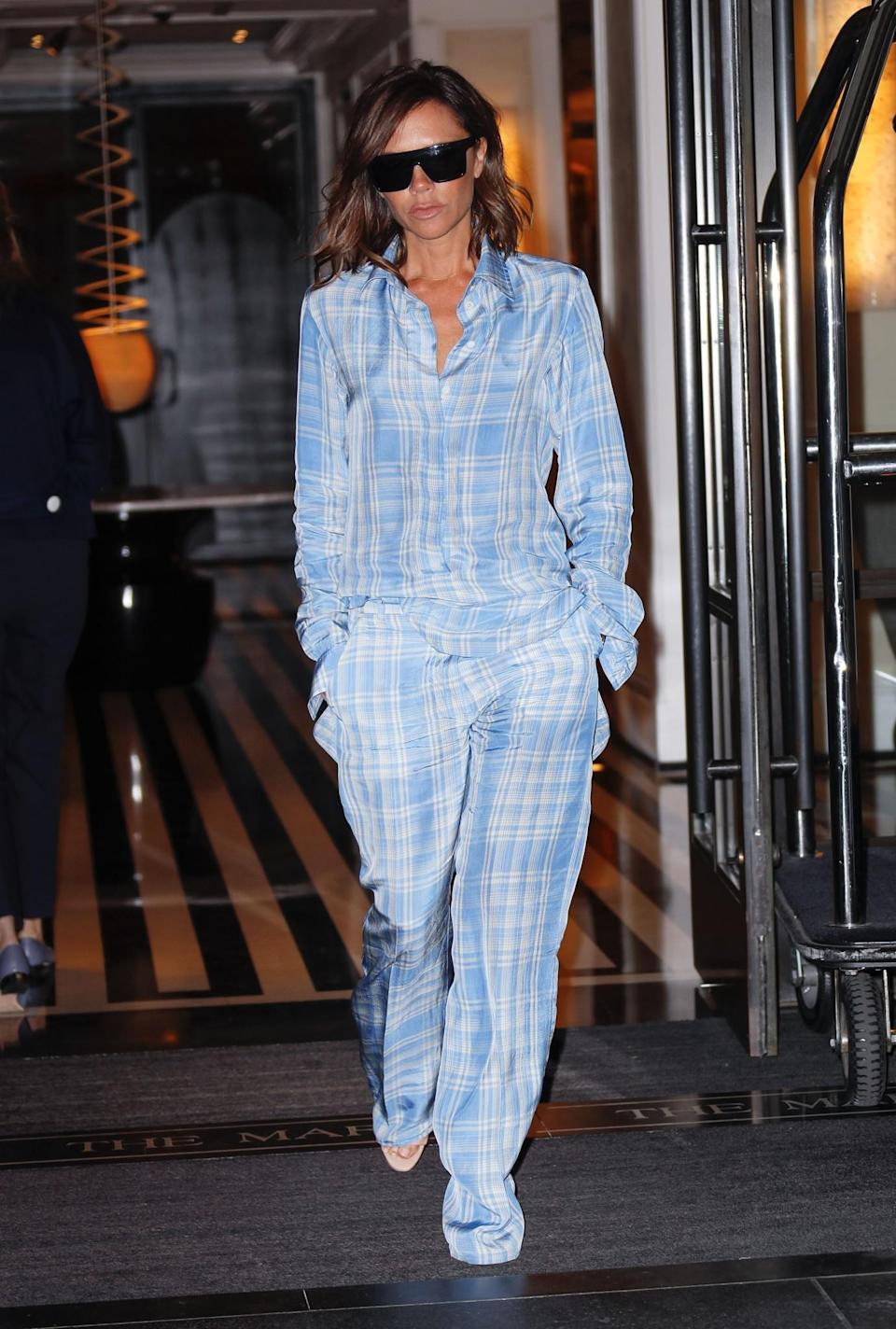 <p>Victoria perfected pyjama dressing while out and about in New York. She chose a slouchy checked pair that made us all want to up our menswear game. <em>[Photo: Getty]</em> </p>