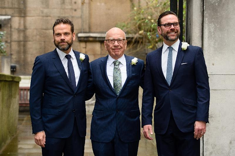 Rupert Murdoch flanked by his sons Lachlan (L) and James (R) -- seen at the father's 2016 wedding -- would see the media-entertainment empire built by the Australian-born media magnate shrink under a deal being discussed with Walt Disney Co. (AFP Photo/Leon NEAL)