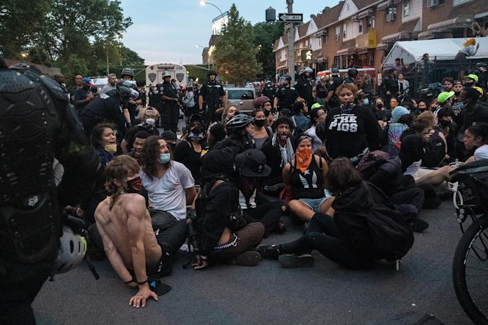 Demonstrators after being detained by police officers during a protest against the death of George Floyd in Mott Haven, the Bronx, on June 4