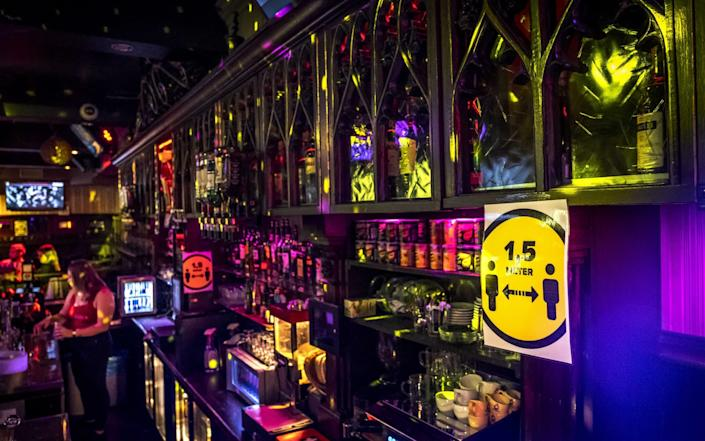 A warning sign to keep distance in a bar in Amsterdam, the Netherlands, 26 September 2020 - Ramon van Flymen/EPA-EFE/Shutterstock
