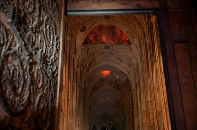Flames and smoke rise from the interior of Notre-Dame Cathedral in Paris on April 15, 2019, after a fire engulfed the building. ( | PHILIPPE WOJAZER AFP/Getty Images)