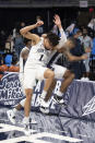 Penn State forward Seth Lundy (1) and guard Myles Dread (2) celebrate after the team's NCAA college basketball game against Minnesota on Wednesday, March 3, 2021, in State College, Pa. (Noah Riffe/Centre Daily Times via AP)