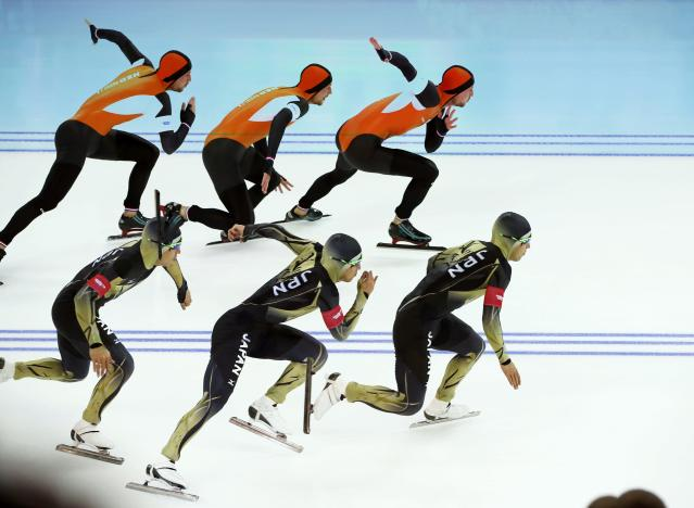 Michel Mulder of the Netherlands (top) and Japan's Keiichiro Nagashima skate during the men's 500 metres speed skating race at the Adler Arena during the 2014 Sochi Winter Olympics February 10, 2014. Picture taken with in camera multiple exposure mode. REUTERS/Marko Djurica (RUSSIA - Tags: OLYMPICS SPORT SPEED SKATING)