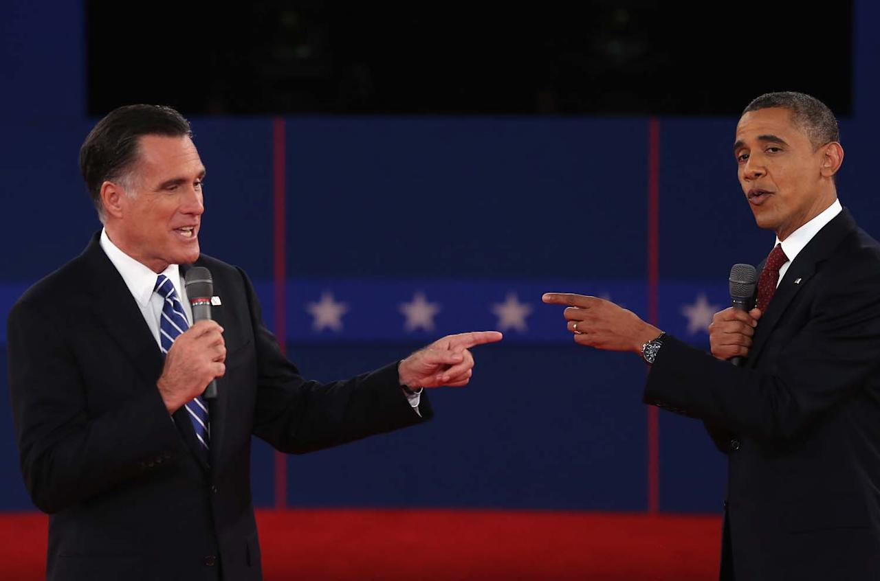 HEMPSTEAD, NY - OCTOBER 16:  Republican presidential candidate Mitt Romney (L) and U.S. President Barack Obama talk to each other during a town hall style debate at Hofstra University October 16, 2012 in Hempstead, New York. During the second of three presidential debates, the candidates fielded questions from audience members on a wide variety of issues.  (Photo by Spencer Platt/Getty Images)