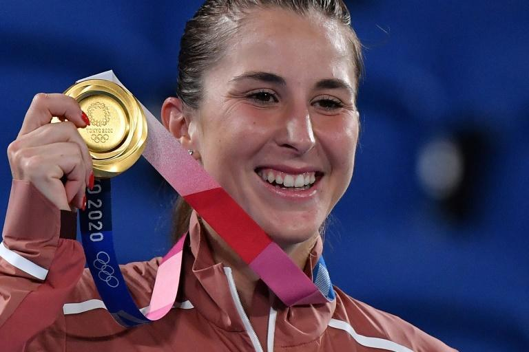 Switzerland's Belinda Bencic poses with her gold medal after beating Marketa Vondrousova in the Olympic final