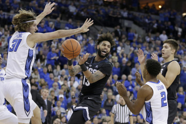 Gonzaga's Josh Perkins (13) passes the ball between Creighton's SamsonFroling (31) and ConnorCashaw (2) during the first half of an NCAA college basketball game in Omaha, Neb., Saturday, Dec. 1, 2018. (AP Photo/Nati Harnik)