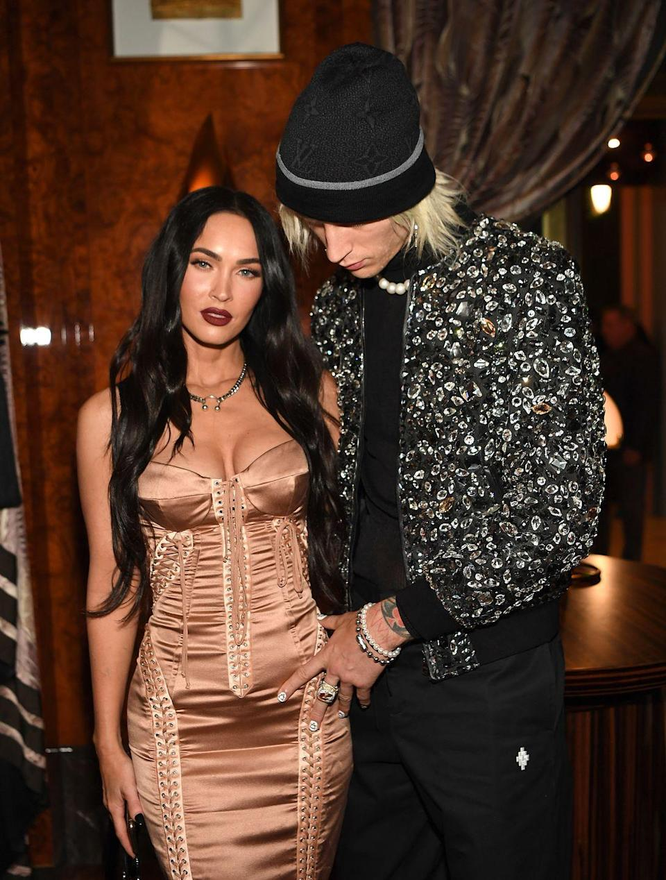<p>The actor wore a nude-coloured Dolce & Gabbana corset dress with on a date with her boyfriend Machine Gun Kelly (also in Dolce & Gabbana) at the UFC match and grand opening of Delilah at Wynn Las Vegas on July 10, 2021. </p><p>She styled the look with a chunky silver chain and a maroon-coloured lipstick. </p>