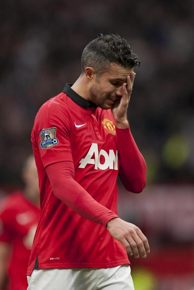 Manchester United's Robin van Persie wipes his face as he walks from the pitch after his team's 1-0 defeat to Newcastle in their English Premier League soccer match at Old Trafford Stadium, Manchester, England, Saturday Dec. 7, 2013. (AP Photo/Jon Super)