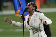 Jazmine Sullivan performs with Eric Church during the national anthem before the NFL Super Bowl 55 football game between the Kansas City Chiefs and Tampa Bay Buccaneers, Sunday, Feb. 7, 2021, in Tampa, Fla. (AP Photo/David J. Phillip)