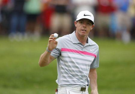 Aug 3, 2014; Akron, OH, USA; Rory McIlroy reacts after sinking his birdie putt on the fifth hole during the final round of the WGC-Bridgestone Invitational golf tournament at Firestone Country Club - South Course. Joe Maiorana-USA TODAY Sports