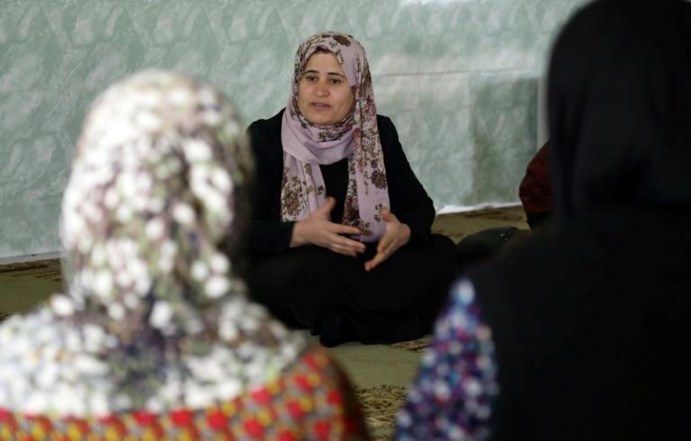 Iraqi Kurdish anti-FGM activist Rasul speaks to women and young girls about the harms of genital mutilation in the village of Sharboty Saghira on December 3, 2018