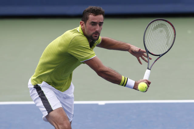 Marin Cilic, of Croatia, returns a backhand against Radu Albot, of Moldova, during first round play at the Western & Southern Open tennis tournament, Monday, Aug. 12, 2019, in Mason, Ohio. (AP Photo/Gary Landers)