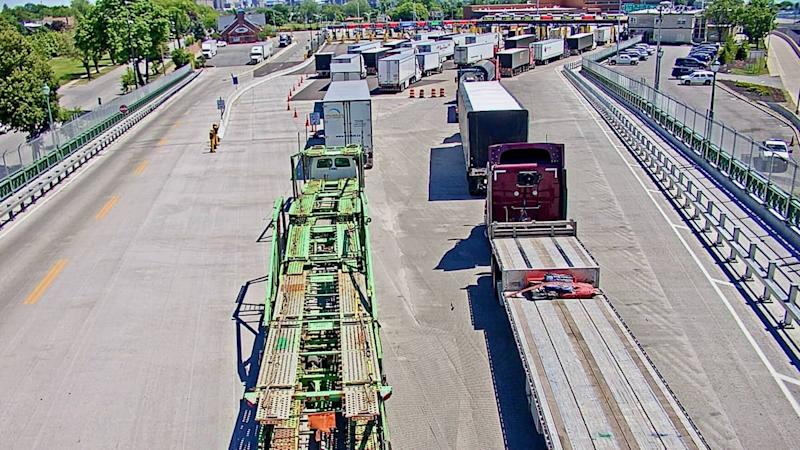 Trucks wait to enter cross the Canada-U.S. border at the Peace Bridge linking Ontario and New York. Cross-border truck traffic rose last week.