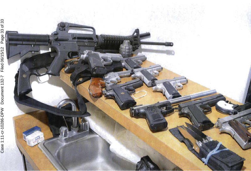 This 2011 photo provided by the U.S. Attorney's office shows guns displayed in the Santa Monica, Calif., apartment where Whitey Bulger and Catherine Greig hid before their arrest in June 2011. The photo was among hundreds of documents unsealed by prosecutors Friday, June 15, 2012, three days after Greig was sentenced in Boston to eight years in prison for helping Bulger during his years as a fugitive. (AP Photo/U.S. Attorney's Office)