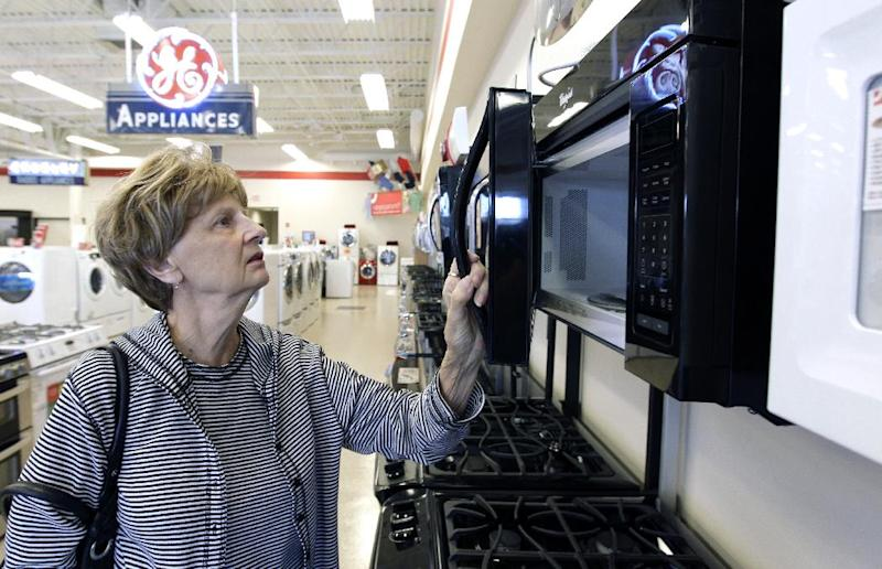 In this Thursday, Oct. 25, 2012, photo, Mary Ann Rotolo shops for a microwave oven at Orville's Home Appliances store in Amherst, N.Y. U.S. companies in October increased their orders of machinery and equipment that signal investment plans by the largest amount in five months, a hopeful sign for future economic growth. Orders for core capital goods, considered a proxy for business investment, rose 1.7 percent in October, the best showing since a 2.3 percent rise in May, the Commerce Department said Tuesday. Orders in this category had slowed (AP Photo/David Duprey)