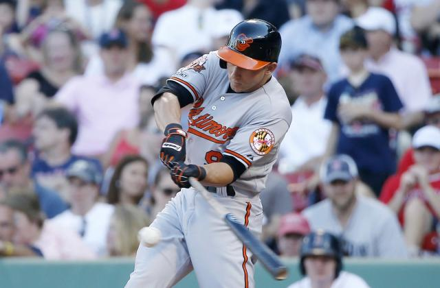 Baltimore Orioles' David Lough hits a triple in the twelfth inning of a baseball game against the Boston Red Sox in Boston, Sunday, July 6, 2014. The Orioles won 7-6. (AP Photo/Michael Dwyer)