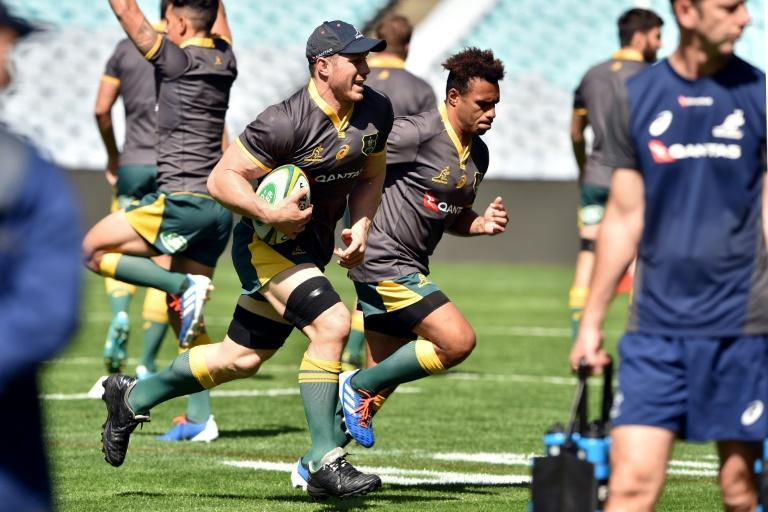 Australia scrum-half Will Genia (R) has won 105 Australia caps and is set to bring the curtain down on an illustrious Wallabies career in Japan