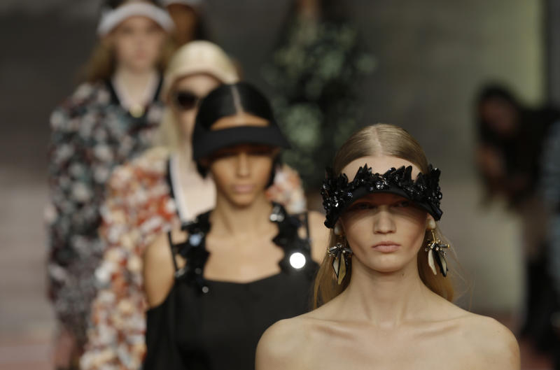 Models wear creations for Marni women's Spring-Summer 2014 collection, part of the Milan Fashion Week, unveiled in Milan, Italy, Sunday, Sept. 22, 2013. (AP Photo/Luca Bruno)