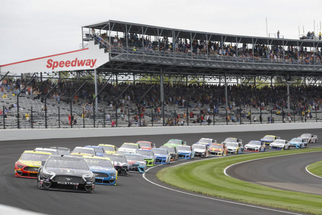 Kevin Harvick leads the field through the first turn on the start of the NASCAR Brickyard 400 auto race at Indianapolis Motor Speedway, Sunday, Sept. 8, 2019, in Indianapolis. (AP Photo/Darron Cummings)