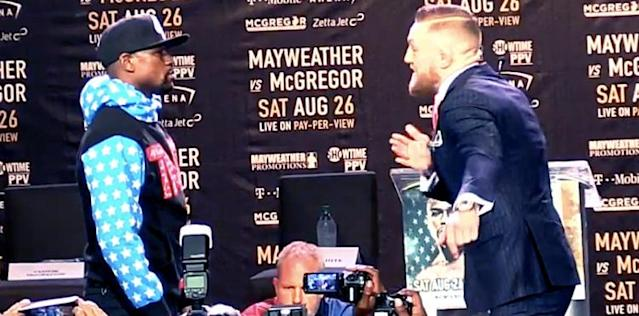 Conor McGregor, Floyd Mayweather Engage in Tense First Face-Off